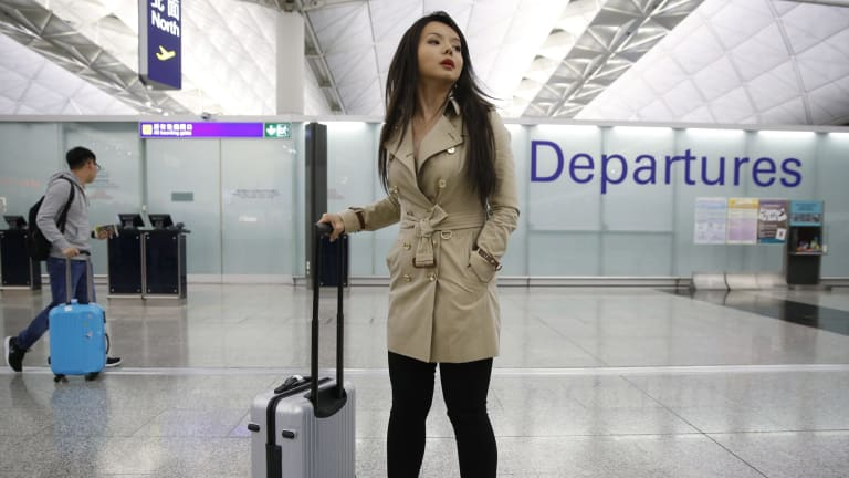 Canada's Miss World contestant Anastasia Lin poses for photographers after she was denied entry to mainland China, at Hong Kong International Airport.