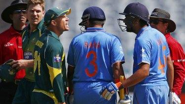 Exchange: David Warner and Rohit Sharma clash at the MCG.