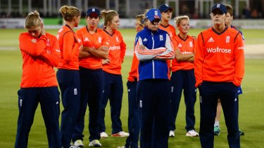 England players look dejected after losing.