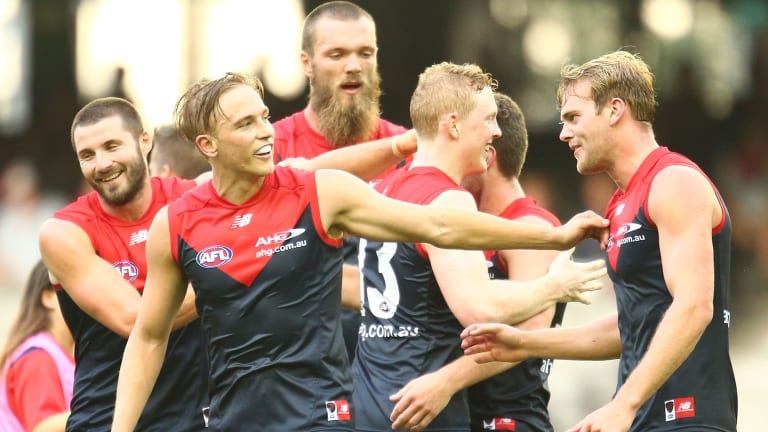 All smiles: The Demons celebrate a Tomas Bugg goal