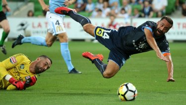 Tumble: Alex Brosque is brought down by goalkeeper Dean Bouzanis to earn the penalty that resulted in Sydney FC opening the scoring.