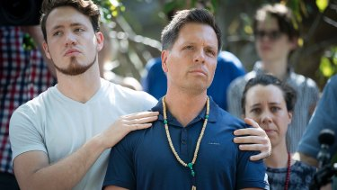 Don Damond is comforted by his son Zach Damond following the death of his fiancee Justine.