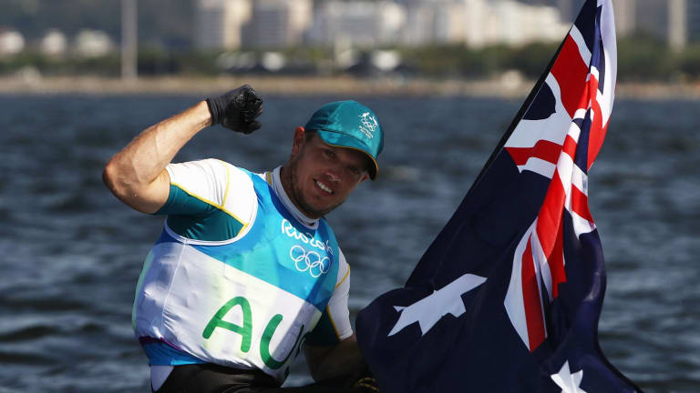 Tom Burton with an Australian flag after the win.
