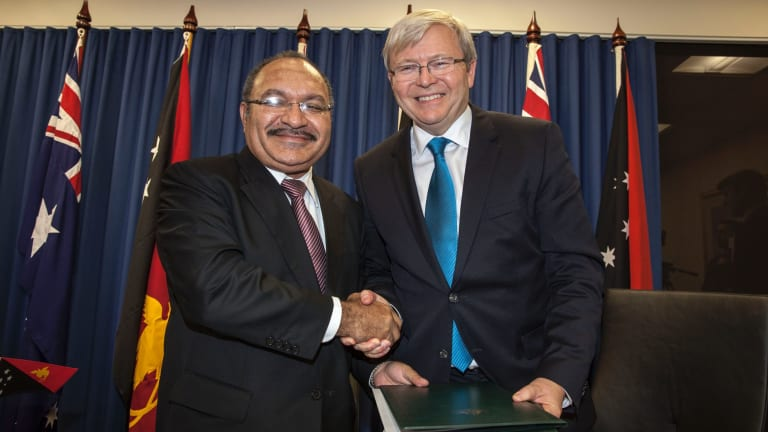 Papua New Guinea's Prime Minister Peter O'Neill and then Australian prime minister Kevin Rudd sign the Manus Island asylum seeker agreement in 2013.