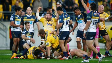 Dane Coles of the Hurricanes celebrates the try scored by Ardie Savea against the Brumbies.