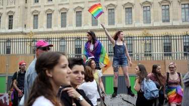 Revelers parade during the annual Gay Pride march in Paris, France in July.
