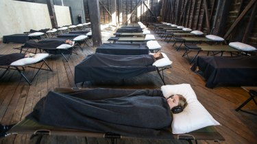 Audience members slow down to experience Marina Abramovic's Beds.