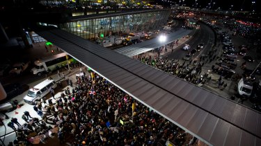 Demonstrators gather outside John F. Kennedy International Airport to protest against US President Donald Trump's executive order.