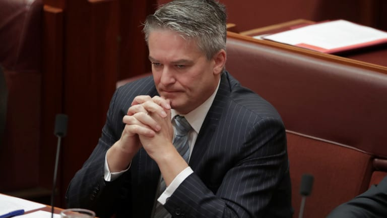 Finance Minister Mathias Cormann became visibly emotional during Penny Wong's speech.