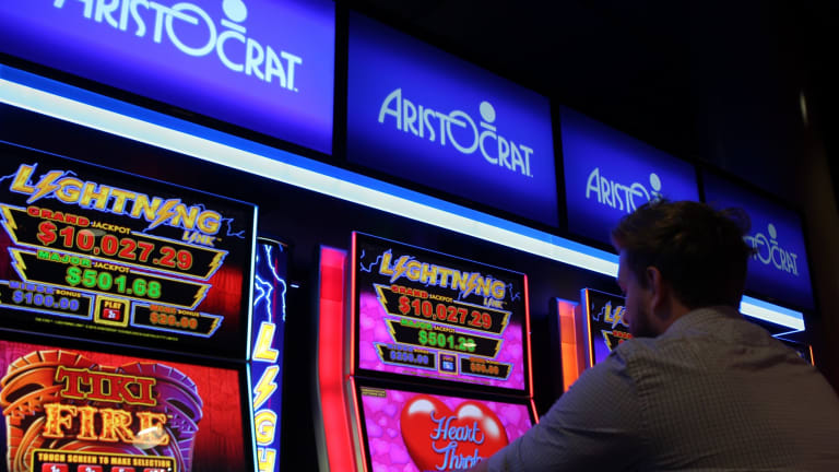The ACT government will start forcing Canberra clubs to surrender poker machine licences from April 2019.