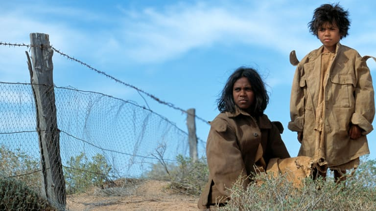 Rabbit Proof Fence follows the journeys of three girls who escape their ''native settlement'' to return to their families.