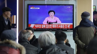 South Koreans at Seoul Railway Station watch a TV news program showing North Korea's announcement of its bomb test earlier this month.