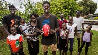 High hopes: South Sudan-born Gach Nyuon with his family.