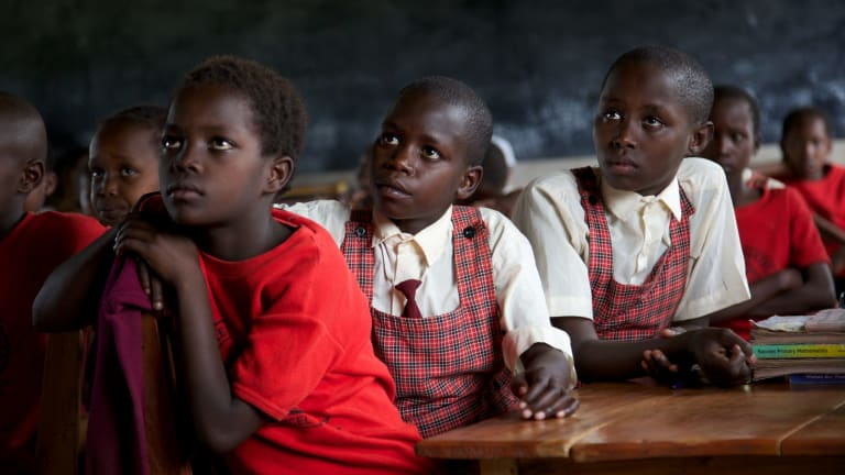 Young Maasai girls listen intently during classes at the Kakenya Centre for Excellence. Their parents have had to agree to leave them unharmed.