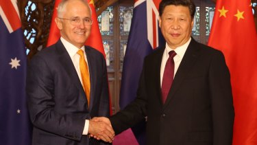 Australian Prime Minister Malcolm Turnbull, left, and Chinese President Xi Jinping shake hands before their meeting in Beijing in April.
