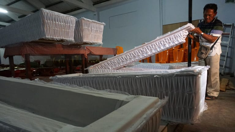 Nine coffins are delivered to the police station in Cilacap on Sunday.