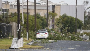 The road into Kurnell is strewn with fallen trees.