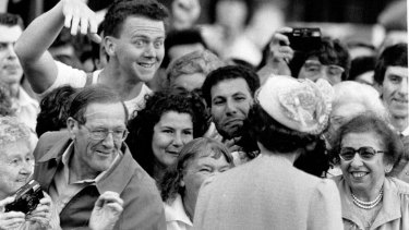 The Queen greets the crowd at the opening of  Darling Harbour, May 4, 1988.