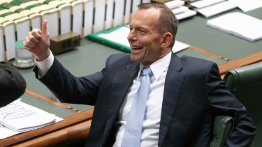 Not all smiles: Prime Minister Tony Abbott is being pressed to do more on climate.