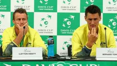 Plenty to ponder: Lleyton Hewitt and Bernard Tomic face the media after Australia's loss to the United States.