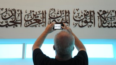 A visitor takes pictures at a mosque in Warsaw, Poland, on Saturday, during The Night of Temples when various religions opened their doors in a campaign against Islamophobia and religious intolerance.
