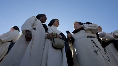 Nuns wait for Pope Francis' arrival on Sunday.