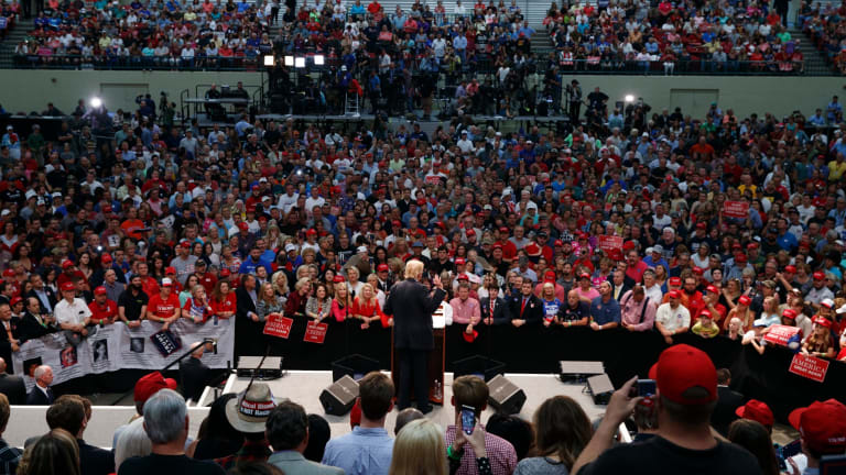 Preaching to the faithful: Trump speaks during a campaign rally.