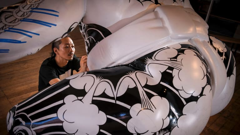 Shohei Otomo with his giant tattooed sumo wrestler at the Backwoods Gallery.