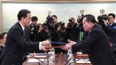 South Korean Unification Minister and chief delegate Cho Myoung-gyon and his North Korean counterpart Ri Son-gwon at the close of the first inter-Korean talks on Tuesday.
