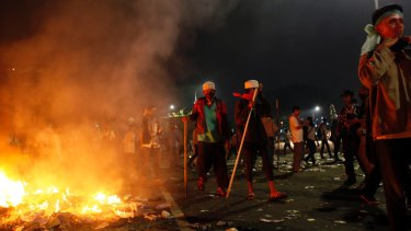 Protesters near a fire during the protests in Jakarta.