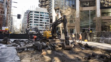Diggers rip up roadway on the intersection of George, Bridge and Grosvenor streets in Sydney's CBD on Saturday.