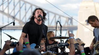 Dave Grohl (left), Taylor Hawkins (back) and Nate Mendel of the Foo Fighters perform on Goat Island in Sydney Harbour in 2011.