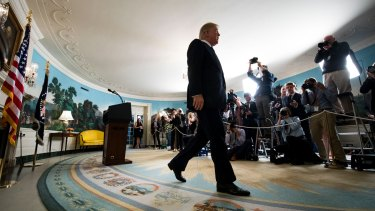 US President Donald Trump exits the Diplomatic Reception Room in the White House in October, after announcing that he would not certify Iran's compliance with the nuclear deal negotiated by his predecessor, Barack Obama.