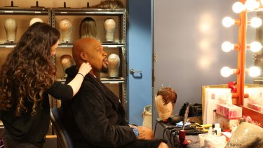 Michael James Scott, who plays the Genie, is made up for Aladdin.