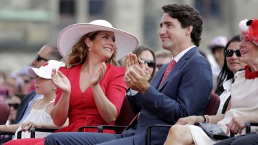 The Trudeaus applaud during Canada Day performances on Friday.