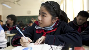 Students work in a classroom at a middle school affiliated with the Jing'An Teachers' College in Shanghai.