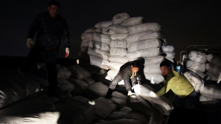South Korean workers unload products made at the Kaesong joint industrial complex in North Korea on Thursday.