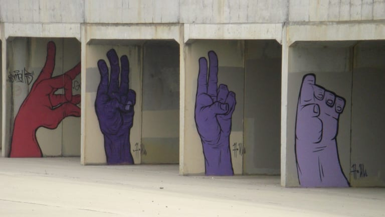Witty, since beiged out, street art in Gungahlin.