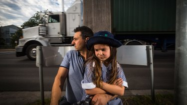 Wembley Primary School parent Con Lagos and daughter Ally, 6, on the corner of Francis Street and Wembley Avenue in Yarraville.
