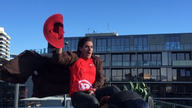 From the wild west: Brad Hogg takes a ride on a mechanical bull on Monday.