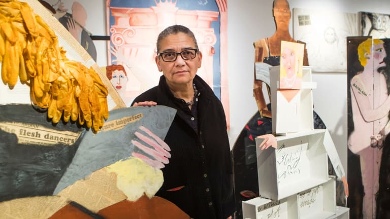 Turner Prize winner Lubaina Himid with one of her works at the Ferens Art Gallery in Hull.