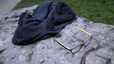 A child's glasses and a jacket lie on a rock in the Parc Monceau after the lightning strike which left 11 people injured.