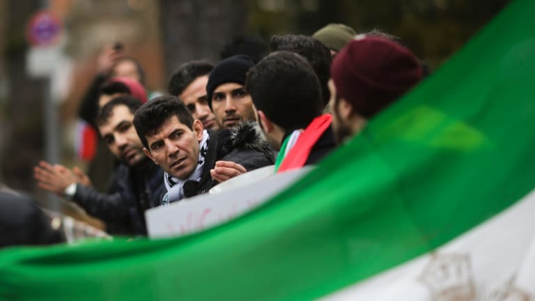 Demonstrators protest against the current government in Iran near the Iranian embassy in Berlin, Germany, on Tuesday.