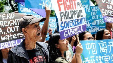Anti-China protesters mount a rally against China's territorial claims in front of the Chinese Consulate in Makati, Philippines.