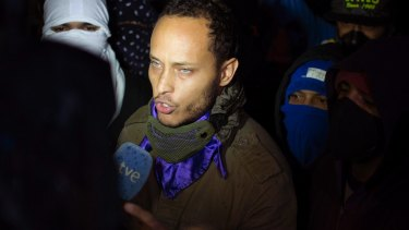 Oscar Perez speaks to the press at a night vigil in July for people killed during anti-government protests.