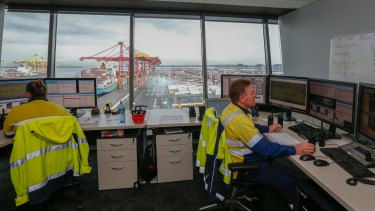 Some of the few human workers who remain at the new automated centre at Port Botany.
