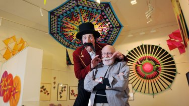 "Master kite designer and internationally known artist Peter Travis with MC Maximus the Magnificent at the launch of ""Wind Air Water – Kites"" at Lake Ginninderra in Canberra in 2012."