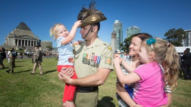 'A sense of belonging': Chris Sharp, who served as a sergeant, holds daughter Ruby, while his wife Jocelyn is pictured with Hayley.
