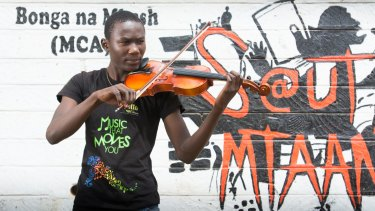 The violin keeps 18-year-old Julius occupied.