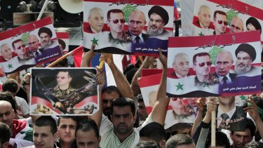 Syrians living in Lebanon hold posters with photos of Syrian President Bashar al-Assad, Russian President Vladimir Putin, Hezbollah leader Sheikh Hassan Nasrallah, and Lebanese Parliament Speaker Nabih Berri. The pro-government rally in front of the Russian embassy in Beirut on Sunday was to thank Russia for its military support.